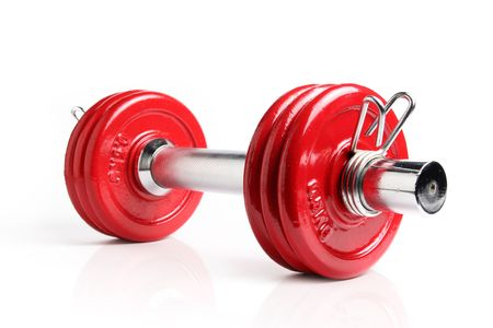 A red dumbbell isolated on a white background, with reflection Stock Photo - 357067