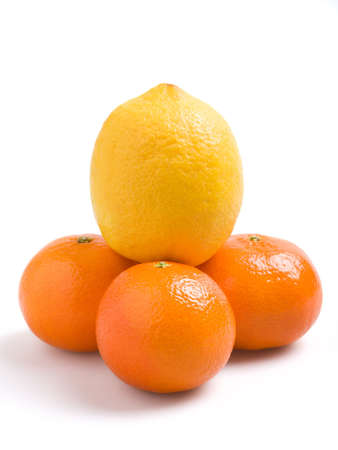 Three tangerines and a lemon on a white background Stock Photo - 746771