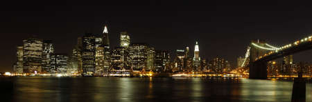 Panoramic view of lower Manhattan skyline at night, from Brooklyn - New York City, USA (high-res panoramic shot stitched from 8 pictures)