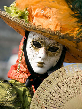 Performers in costume gathered on a quay of the river Seine for a Venetian carnival parade in Paris, France photo