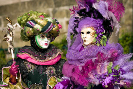 parades: Performers in costume gathered on a quay of the river Seine for a Venetian carnival parade in Paris, France