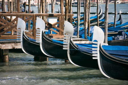 piazza san marco: Prows of gondolas moored by Saint Marks square - Venice, Venezia, Italy, Europe