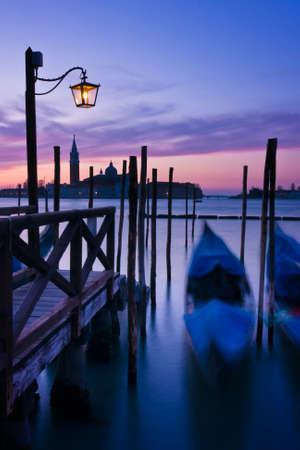 sea mark: Gondolas moored by Saint Marks square at dawn with San Giorgio di Maggiore church beyond - Venice, Venezia, Italy, Europe