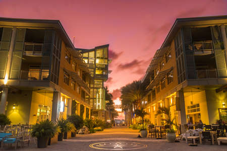 Sunset over a pedestrian zone at Camana Bay a Caribbean waterfront town on Grand Cayman, Cayman Islands
