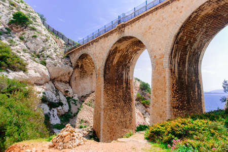 Close up of a railway bridge on the Estaque mountain range by the Mediterranean sea on the Cote bleue, Provence France