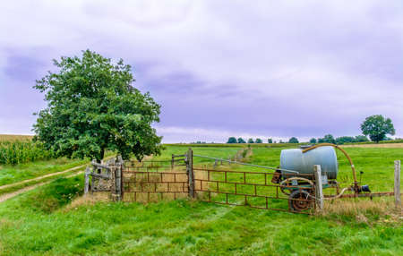 Water cistern in a Normandy field on a overcast day in summer