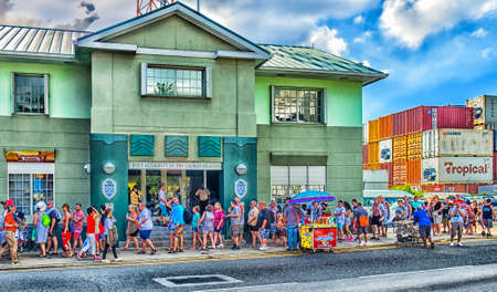 Grand Cayman, Cayman Islands, tourists at George Town port in the Caribbean, queuing to re-embark on their cruise ship