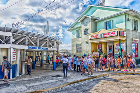 George Town, Grand Cayman, Cayman Islands, tourists by the port North terminal queuing to re-embark on their cruise ship