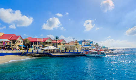 Grand Cayman, Cayman Islands, tourists embarking on a marine shuttle at George Town port South terminal Editorial