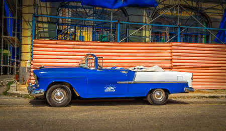 Havana, Cuba, July 2019, view of a blue 1950s Chevrolet Bel Air Convertible parked used as a rental car for tourists Redactioneel