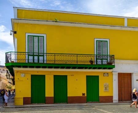 Havana, Cuba, July 2019, view of a colourful building in the Calle Obispo a street in the heart of the old and most touristic part of the city 写真素材