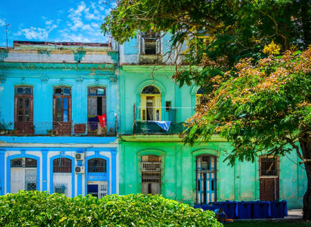 Havana, Cuba, July 2019, view of two colorful buildings in Calle San Juan de Dios in the old part of the city