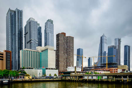N.Y.C, U.S.A, May 2019, view from a pier by the Hudson River of the 12th Avenue with the Consulate General of the People's Republic of China building, the Silver Towers and the River Place buildings