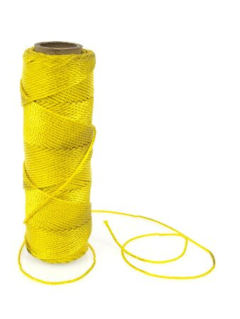 Yellow thread spool isolated on white background