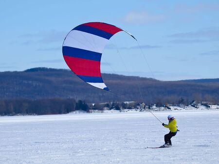 Men ski kiting on a frozen lake Stock Photo - 6479063