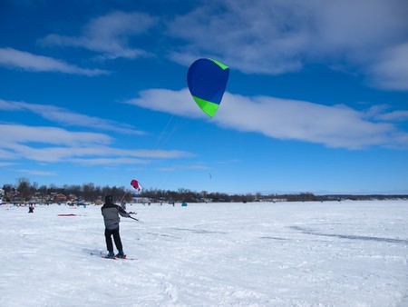 Men ski kiting on a frozen lake Stock Photo - 7657043