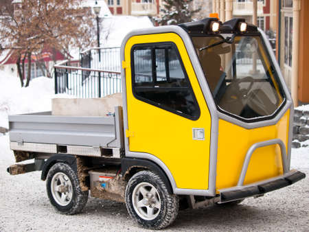 Specialized utility vehicule for ski village going up hill in snow photo