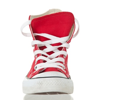 Vintage red shoe closeup on pure white background photo