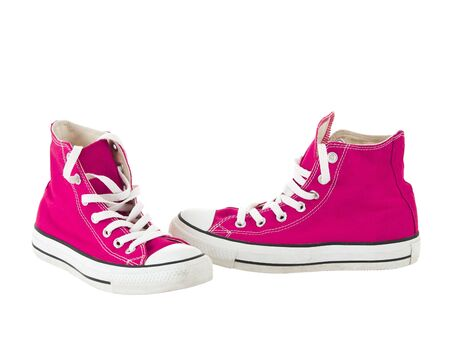 Vintage hanging pink shoes on pure white background Stock Photo