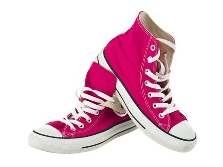 fuschia: Vintage hanging pink shoes on pure white background Stock Photo