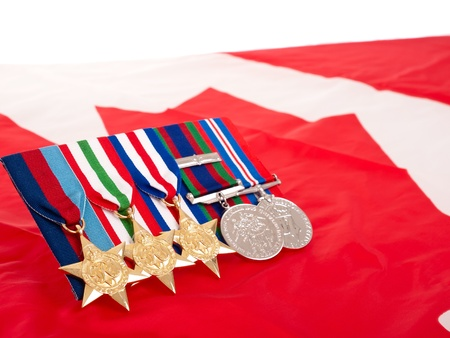 World War II Canadian medals over flag photo
