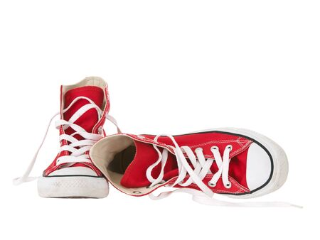 Vintage hanging red shoes fallen on pure white background
