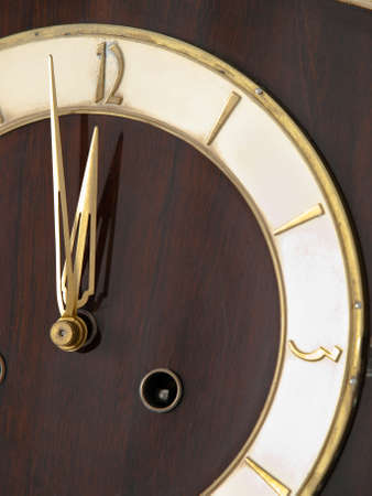 Old chessnut clock ivory dial with  golden accents