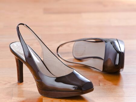 Classic patent leather shoes on wood floor background photo