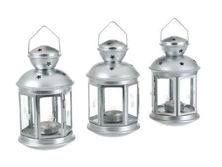 Tin grey metal lantern trio row on pure white background