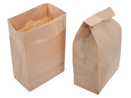 Old-fashioned lunch bag with wooden clothes pin on white background photo