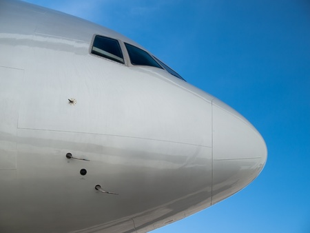 Airplane nose agaist clear blue sky