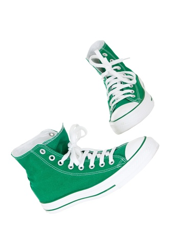 Vintage hanging green shoes on pure white background photo
