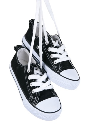 Vintage hanging black shoes on pure white background 版權商用圖片
