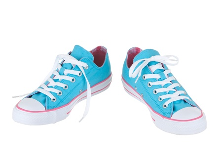 Vintage hanging blue shoes on pure white background Фото со стока
