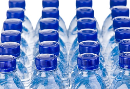 Rows of water bottles isolated on white background