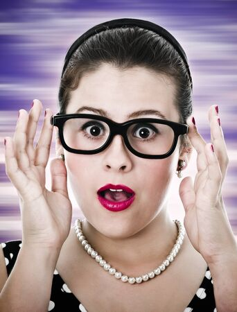 Pin-up 50s style nerdy teenage girl suprised on purple background photo