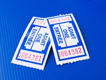 Pair of tickets on techno blue background