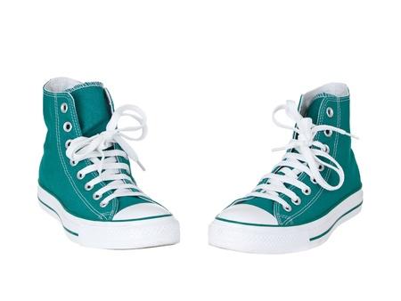 スニーカー: ヴィンテージ純粋な白い背景の上の緑の靴をぶら下げ 写真素材