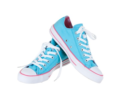 Vintage hanging blue shoes on pure white background 版權商用圖片
