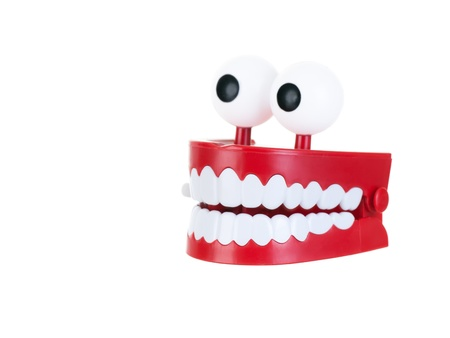 Chattering teeth on a pure white background photo