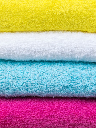 Fresh towels stack closeup front view on white background photo