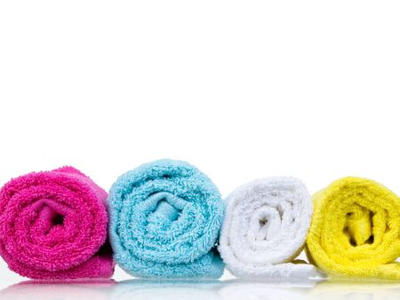 Fresh towels rolled-up front view on white background