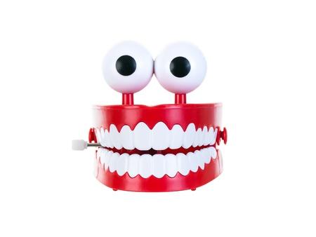 Castañeteo de dientes sobre un fondo blanco puro Foto de archivo - 13440137