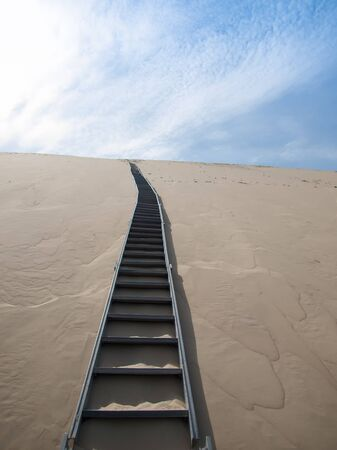 Steep stairs going on top of sand Dune of Pyla, Arcachon, France