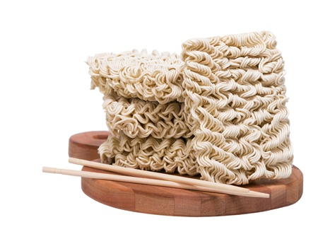 instant ramen: Ramen instant raw noodles on wooden plank 3 4 with chopsticks general view Stock Photo