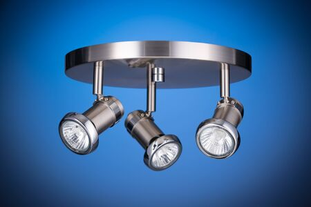 lighting fixtures: Ceiling light fixture isolated on blue background