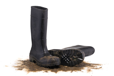 masculin: Muddy rubber fallen boots 34 view isolated on white background