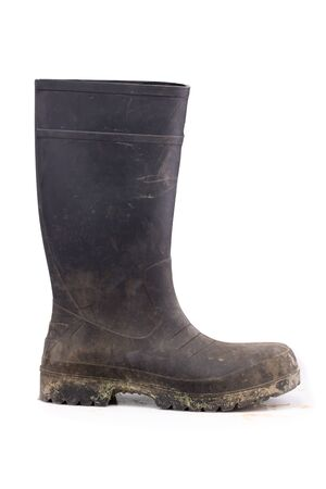 masculin: Muddy rubber boot side view isolated on white background