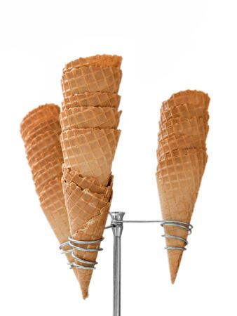 cones: Ice cream waffle cones on dispenser isolated on white background