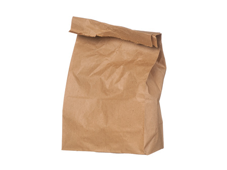 paper bag: Brown paper bag closed standing isolated on white background